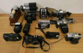 A collection of camera's and equipment, to include Nikon, Praktika and Kodak (2).