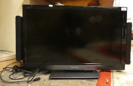 A Panasonic TX-L32E30B television with external speaker system, hand set.
