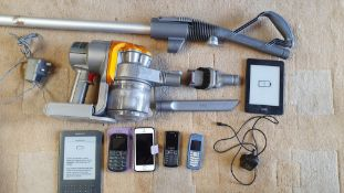 A Dyson DC16 hand held vacuum cleaner with accessories, 2 x Amazon Kindles, and 4 x mobile phones.