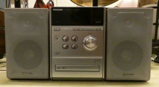 A Panasonic CD stereo system SA PM33 with speakers and a sewing machine