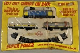 A Brimtoy clockwork train set, boxed, together with a quantity of Double O track and points.