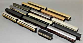 Sixteen Double O gauge carriages.