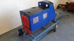 "A 5"" gauge tank engine, with petrol engine for a ride on garden set up, 85 cm, mounted on a trolley."