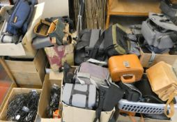 A large quantity of empty camera bags and cables