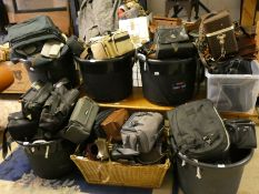 A very large collection of empty camera bags