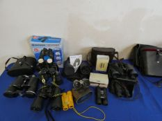 A collection of binoculars including Konica, Miranda, Bresser, Boots and Tasco.
