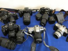 A collection of cameras to include Nikon F65 with lens, Pentax MZ50 with lens, Canon 5000 with lens,