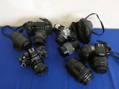 A Pentax SFT with lens and case, a Yashica 300 with lens and case, a Pentax ME super with lens and