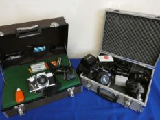 A Minolta X700 and X300 with lens in alloy case, together with a Praktica MTL3 in hard case.