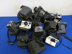 A collection of Polaroid and Instamatic cameras.