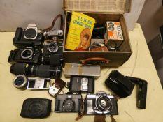 A Canon EOS-50E camera, a Halina 'Anast', Miranda, Olympus cameras, together with a Carl Zeiss '