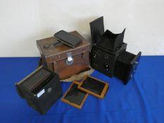 A Thornton Pickard box camera, in case and a smaller box camera.
