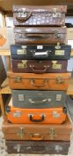 A small crocodile suitcase with padded interior and 8 other suitcases and briefcases (9).