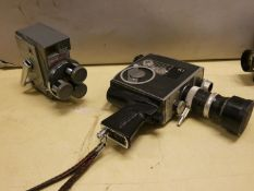 A cased Bolex Zoom Reflex cine camera, a JVC digital VHS camera, a Sony digital video camera,