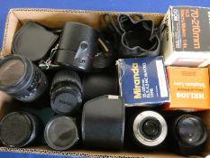 A collection of camera lens, to include Sigma zoom 70-210, Canon 75-300, Tamron 70-210, Vivitar 70-