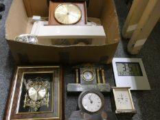 A collection of mantle clocks, carriage, and travel clocks, including a figurative brass table clock