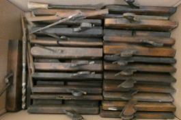 A collection of wooden block & box planes and clamps.