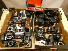 A large quantity of cameras and camera bodies, to include, Exakta 'varex II', Yashica TL-Super,