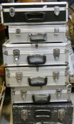 4 alloy camera cases together with 2 other camera cases