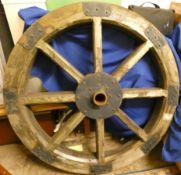 A substantial horse cart wheel. 124 cm diameter (very heavy)