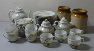 A Japanese hand painted fine porcelain tea service, comprising tea pot, sugar bowl, milk jug, 8