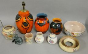 A collection of Poole pottery, including a standard lamp, various vases, model of a seal and other