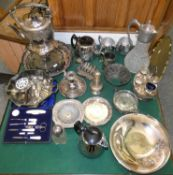 A box of miscellaneous plated ware, including a spirit kettle, chamber sticks, cased and loose