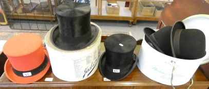 Three top hats and two Bowlers.