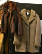 A ladies sheepskin jacket size 16 and a fur coat.