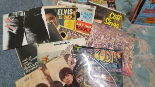 A box of over one hundred vinyl LP's and singles, primarily from the 1970's/80's.