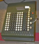 A portable typewriter and a U.S. built comptometer from Felt & Tarrant together with relevant