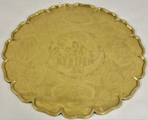 A Chinese Qing dynasty brass heavy table top, of circular form with applied border, the field