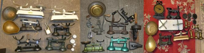 A set of baby scales with cane basket, together with various other sets of scales, brass weights,