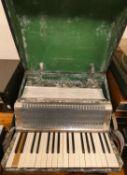 An Alvari piano accordion in case.