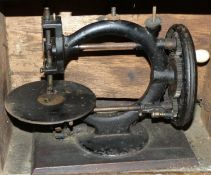 A Wanzer manual sewing machine, circa 1880, decorated with black lacquer, Time Utilizer Trade