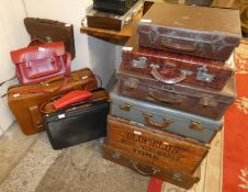 A selection of leather and other suitcases, satchels and a wooden box marked Oldfields, wine