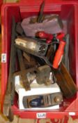 A box of various tools, to include wooden planes, drill, door knobs, cold chisels, gauges and a