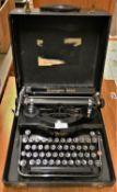 A Remington Rand model 1 typewriter, case.