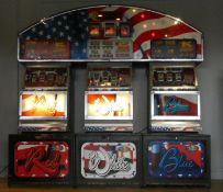 A Vivid by Barcrest slot machine group, Red, White and Blue, with overhead lighting board, in