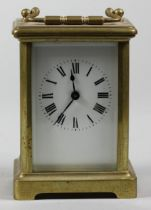 A French brass carriage time piece, the white enamel dial unsigned, the movement stamped France,