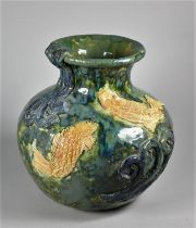A mid-20th century studio pottery baluster vase, with applied fish and wave motifs, impressed