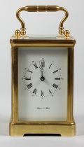 A large English brass carriage time piece, the white enamel dial signed Mappin & Webb, the 11