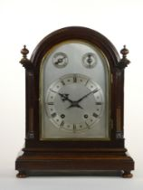 An Edwardian mahogany mantle clock, with silvered dial, subsidiary chime/silent and fast/slow dials,