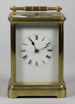A large brass repeating carriage clock, the white enamel dial unsigned, the movement striking the