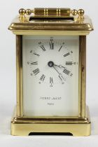 A French brass carriage time piece, the white enamel dial signed Pierre Jacot, Paris, height with