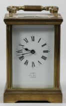 A brass carriage time piece, the white enamel dial signed Dent, Pall Mall, London, height with