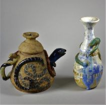 Louis Richwald, a white and blue glazed stoneware vase, with lizard applied, engraved on base,