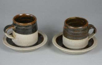 A Colin Pearson teacup and saucer pair, stoneware with tenmoku glaze, height 7 cm