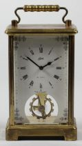 A German brass carriage time piece, the white enamel dial signed Schatz, 8 day, Made in Germany,
