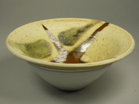 Charles Bound (b.1939), a set of three small bowls with two white bases and brown and green
